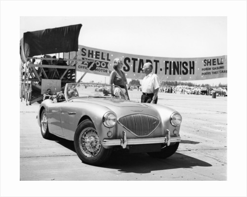 Donald Healey with an Austin Healey at a motor race by Anonymous