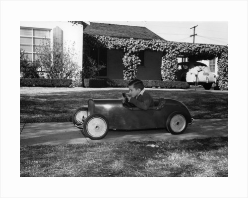 Boy in a pedal car by Unknown