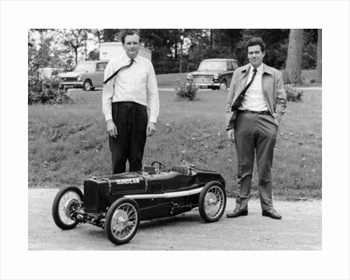 Two men standing by a miniature Sunbeam pedal car, 1960s by Unknown