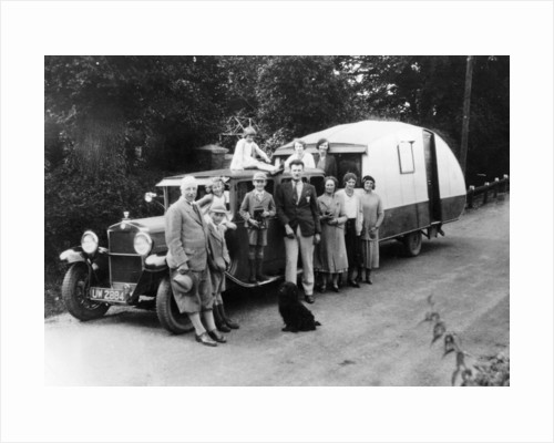 Family group with their 1930 Fiat towing a caravan by Anonymous