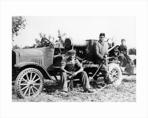 Farmworkers with a tractor by Anonymous