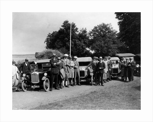 Group of people and cars on a country road by Anonymous