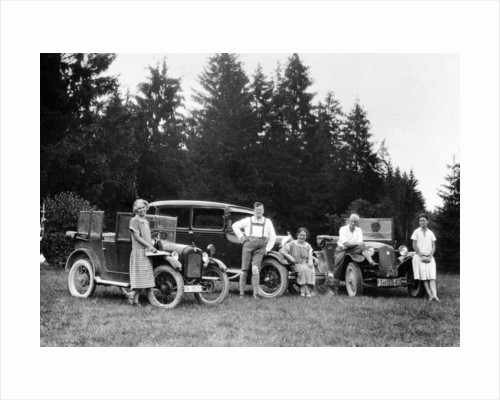 A group of people on an outing with their cars by Anonymous