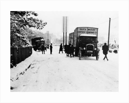 A Hay's Wharf Cartage Company Ltd van along a snowy A30 by Anonymous