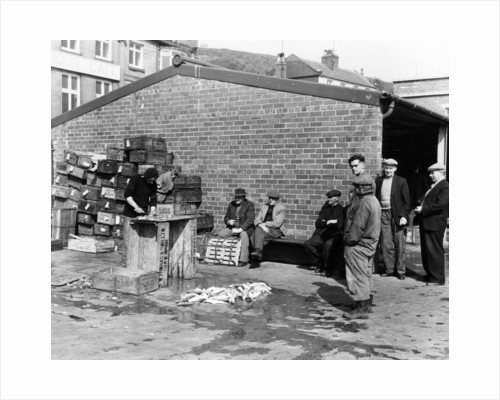 Gutting fish outside a warehouse in Whitby by Anonymous