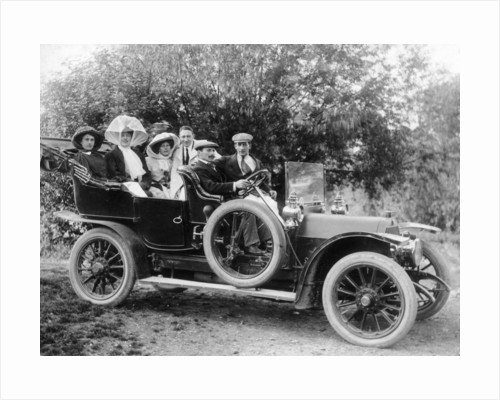 A group of men and women taking an outing in a 1907 Mercedes by Anonymous