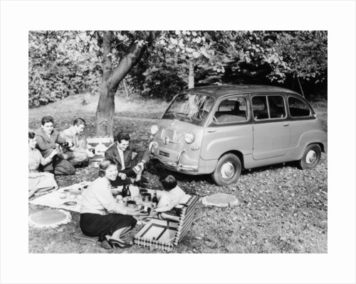 People enjoying a picnic beside a 1956 Fiat 600 Multipla by Anonymous