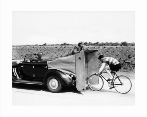 Cyclist training behind an Auburn car by Anonymous