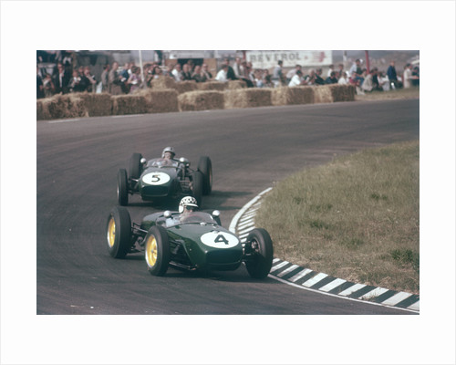 Innes Ireland driving a Lotus 18 by Anonymous