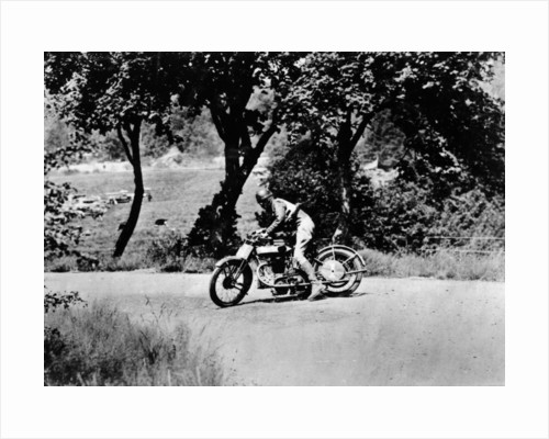 A man on a Norton bike taking part in the Belgian Grand Prix by Anonymous