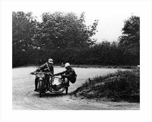 G Tucker racing a Norton bike by Anonymous