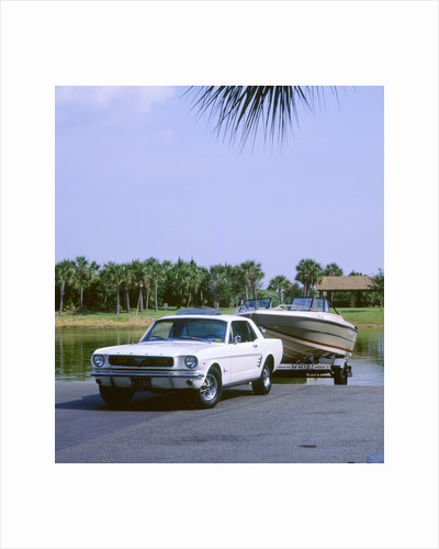 1967 Ford Mustang towing a boat by Unknown