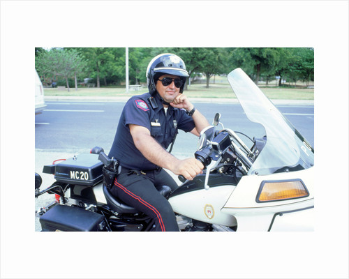 Policeman on 1994 Harley Davidson, Austin Texas by Unknown