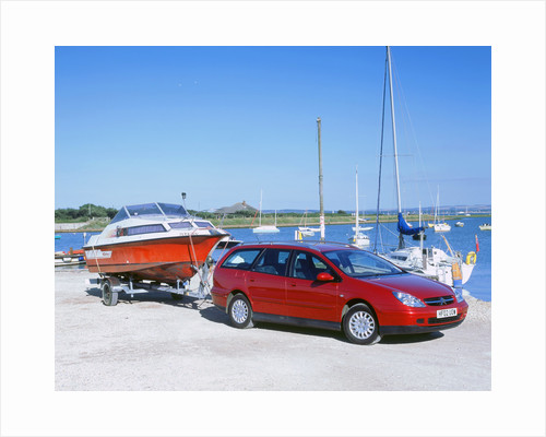 2002 Citroen C5 hdi towing a boat by harbour by Unknown