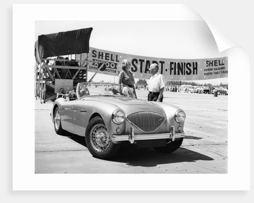 Donald Healey with an Austin Healey at a motor race by Unknown