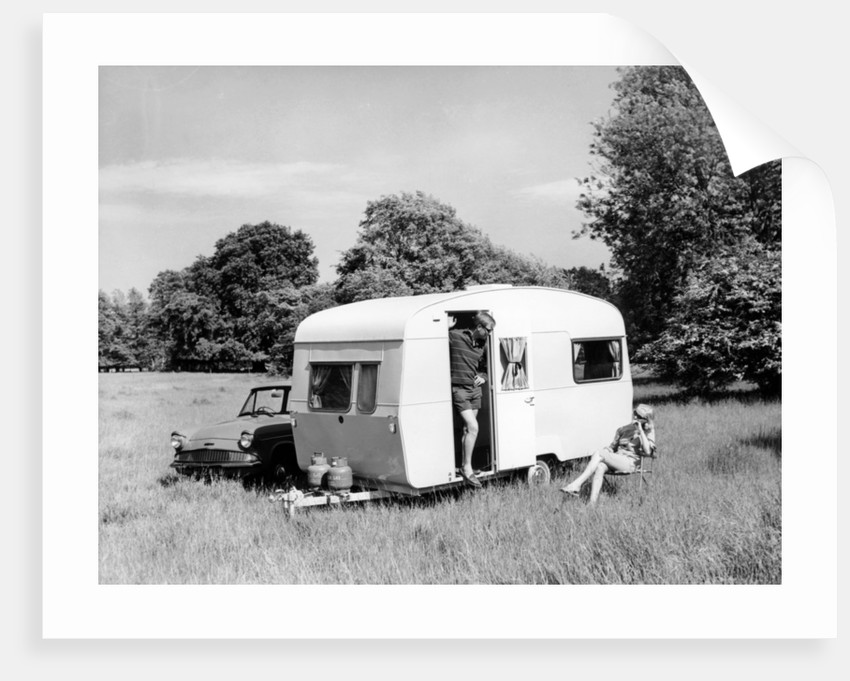 Couple on holiday with their 1963 Sprite Alpine caravan, (c1963?) by Unknown
