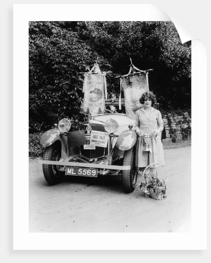 A woman and her prize winning Ballot car by Anonymous