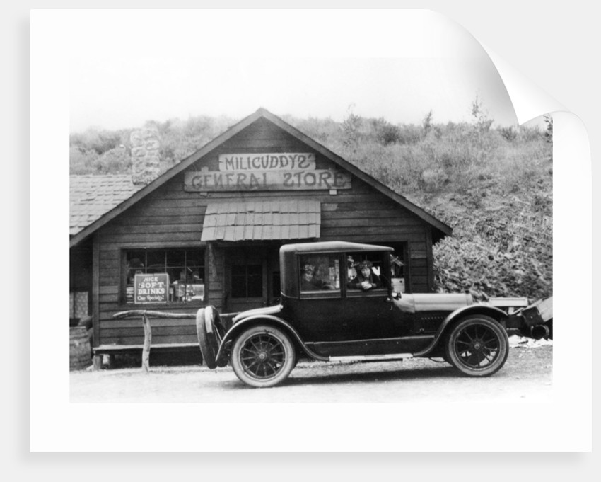 1916 Cadillac V8 car, parked outside a general store, USA by Anonymous