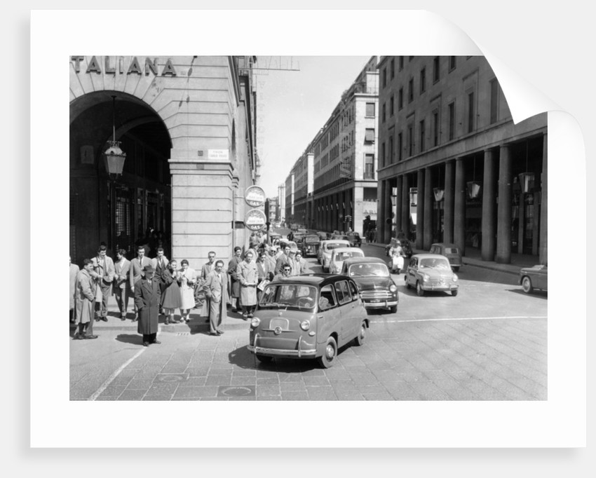 Fiat 600 Multipla leading a procession of Fiats by Anonymous