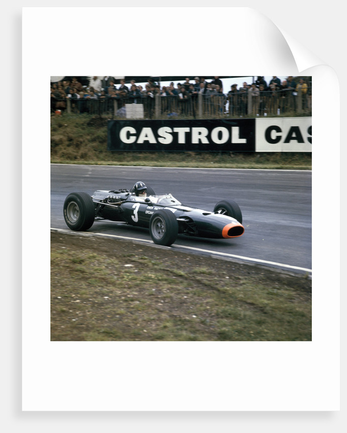 Graham Hill racing a BRM P261 by Anonymous