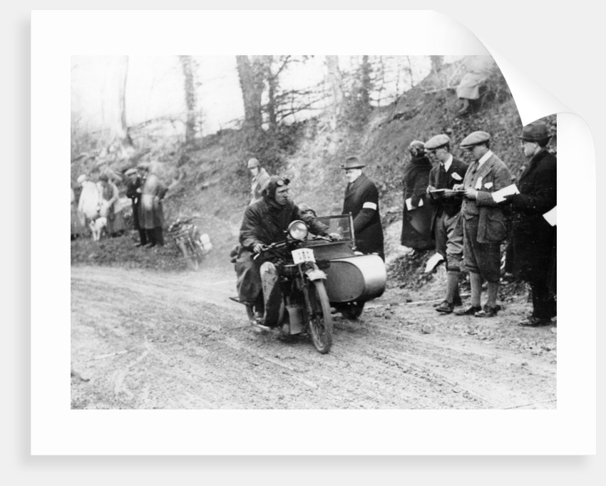 A competitor riding a Norton, competing in the Colmore Cup Trial by Anonymous
