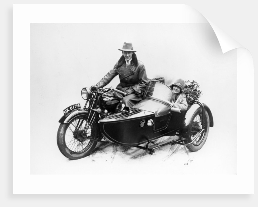 Man riding an AJS motorbike with a woman in the sidecar by Anonymous