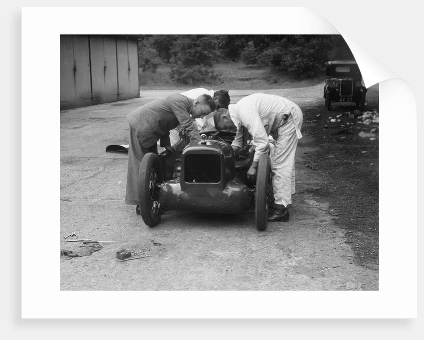 Mechanics working on Leon Cushman's Austin 7 racer for a speed record attempt, Brooklands, 1931 by Bill Brunell