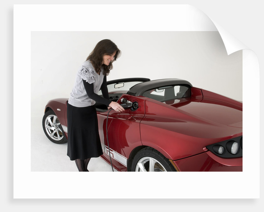 2010 Tesla Roadster electric car being re charged by Unknown