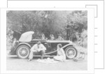 Couple having a picnic by an MG TA Midget by Anonymous