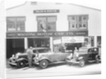 1932 Ford V8 in front of a car showroom by Anonymous