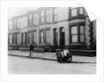 An 'Orderly Boy' and his cart sweeping a street by Anonymous