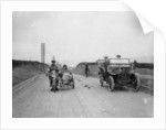 A motorcycle and sidecar passing a car and cyclist on the road by Unknown