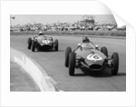 Graham Hill and Jack Brabham racing in the XI British Grand Prix by Anonymous