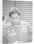 Gehard Berger listening to a member of the Ferrari team by Anonymous