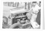 Attilio Marinoni, chief mechanic of Scuderia Ferrari, with an Alfa Romeo by Anonymous
