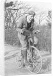 A young Lord Nuffield riding a bicycle down a country lane by Unknown