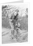 A young Lord Nuffield riding a bicycle down a country lane by Anonymous