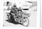 A Harley-Davidson with a sidecar by Anonymous