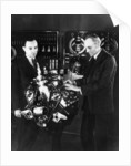 Henry and Edsel Ford with a Ford V8 engine by Anonymous