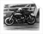 A Norton in action in the Isle of Man TT by Anonymous