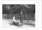 Boy in 1908 Mercedes pedal car by Unknown