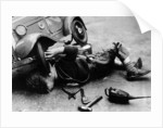 Michael Ware repairing his pedal car by Anonymous