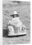 Girl in a 1948 vintage Austin J40 pedal car by Unknown