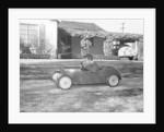 Boy in a pedal car by Unknown