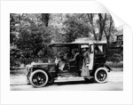 Woman stands by a 1907/8 Daimler by Unknown