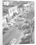 Street scene with cars parked, USA, c1952 by Unknown