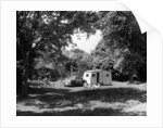 A family relaxing on holiday with their 1951 Vauxhall Wyvern and caravan by Anonymous