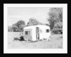 Couple on holiday with their 1963 Sprite Alpine caravan by Anonymous