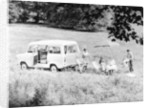 Family group with a 1968 Ford Explorer Camper van by Anonymous