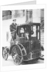 Woman passenger in a 1910 taxi cab by Anonymous